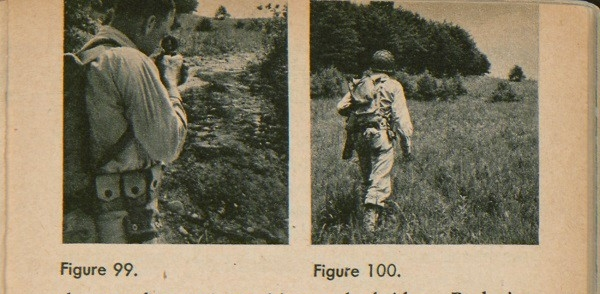 Figure 99: A soldier setting his sight with a compass. Figure 100: A soldier walking towards his destination.