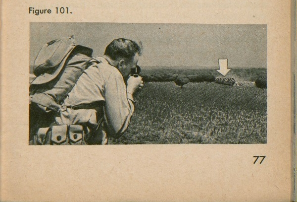 Figure 101: A soldier looking through a compass at a bridge.
