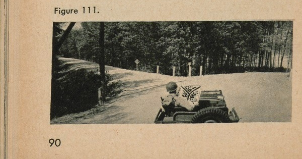 Figure 111: A soldier in a car at a fork in the road looking at a map.