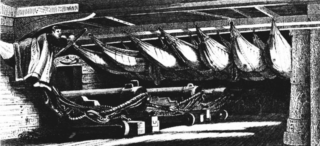A starboard battery at night, with crewmen asleep in their hammocks