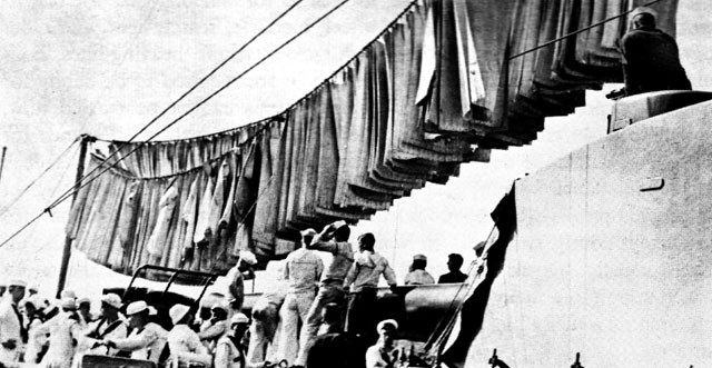 Scrubbed hammocks aboard the USS KANSAS during a training cruise in 1910