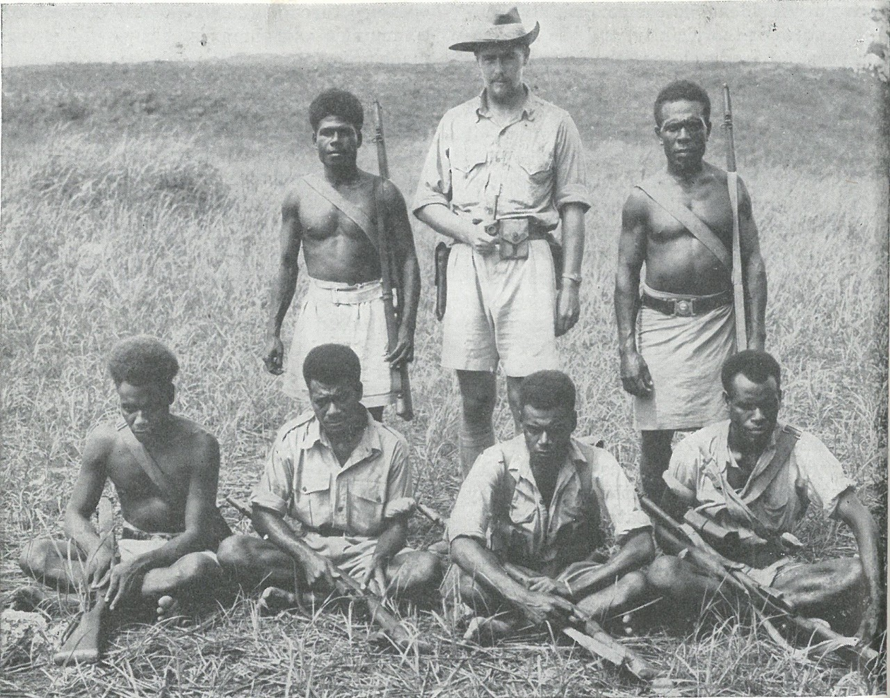 LOYAL NATIVES such as these, together with their leader, Captain Martin Clemens, Australian government representative on Guadalcanal (even while in Japanese hands) rendered invaluable services to the Marines. These natives were all members of the Solomon Islands police force.