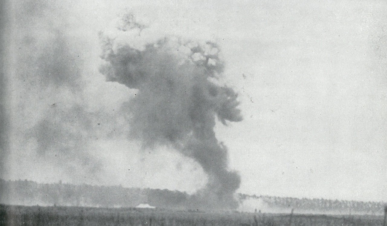 UNREMITTING JAPANESE AIR ATTACKS pounded Henderson Field on 24-25 October while U.S. aircraft were grounded by heavy rains which bogged down the airstrip. This shows a hit by a 500-pound bomb.