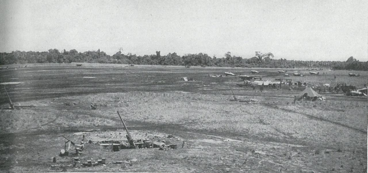 90mm ANTIAIRCRAFT GUNS of the 3d Defense Battalion emplaced at Henderson Field forced Japanese bombers to 25,000 feet while Marines of the 1st Engineer Battalion labored to finish the strip. This picture was taken after the field had become fully operational.