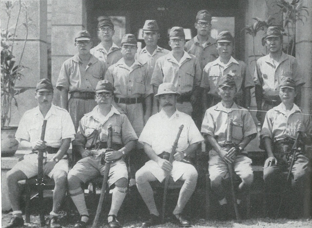 KAWAGUCHI BRIGADE HEADQUARTERS landed near Tasimboko from destroyers on 6 September. Forty-eight hours later, its base was attacked and destroyed by the 1st Raider Battalion. This picture, with mustachioed Major General Kawaguchi in center, was probably taken in the Philippines.