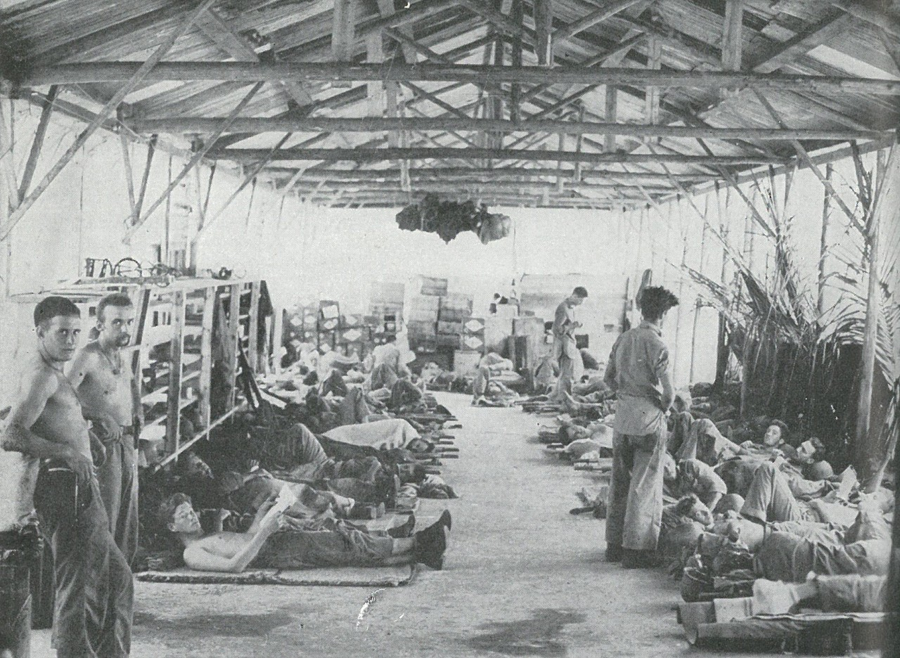 MALARIA BEGAN TO MAKE ITSELF FELT by October. Most of the Marines in this former Japanese sick bay are suffering from malaria, as great a casualty-producer in jungle war as enemy bullets.