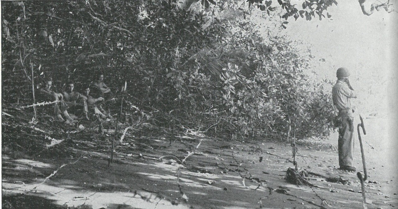 BEACH DEFENSES were hastily established with such meager materials as had been left by the retiring transports. Japanese counter-landing behind the Marine perimeter was a constant threat during early days of the campaign.