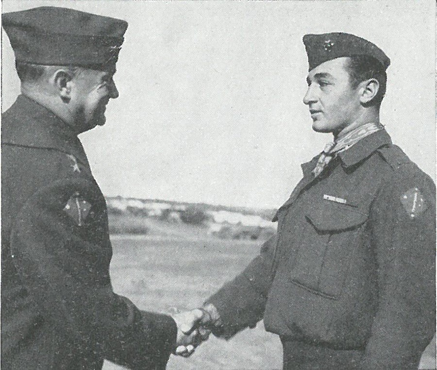 SGT MITCHELL PAIGE receives the Medal of Honor from Gen Vandegrift as a reward for outstanding heroism while manning a machine-gun of the 2d Battalion, 7th Marines.