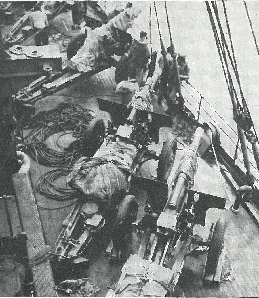 ENROUTE TO THE OBJECTIVE, 105mm howitzers of the 5th Battalion, 11th Marines are lashed on deck.