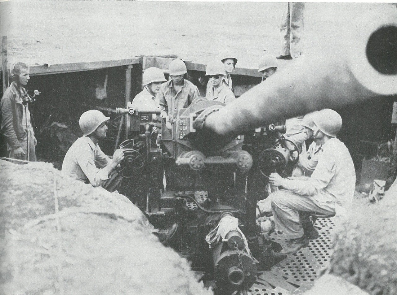 ANTIAIRCRAFT GUNNERS of the 3d Defense Battalion provided the sole air defense for Henderson Field during the critical hours while U.S. airplanes were grounded.