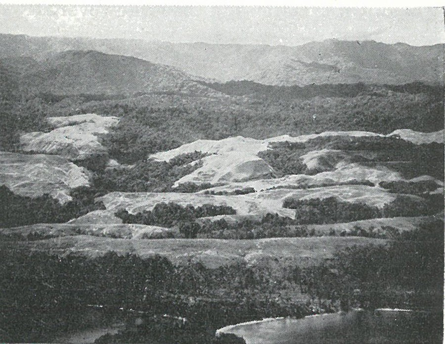 GUADALCANAL PRESENTS A VARIED TERRAIN: this view looking south over Point Cruz shows the jumble of sharp-grassed ridges, foothills and mountainous jungle which was Guadalcanal.