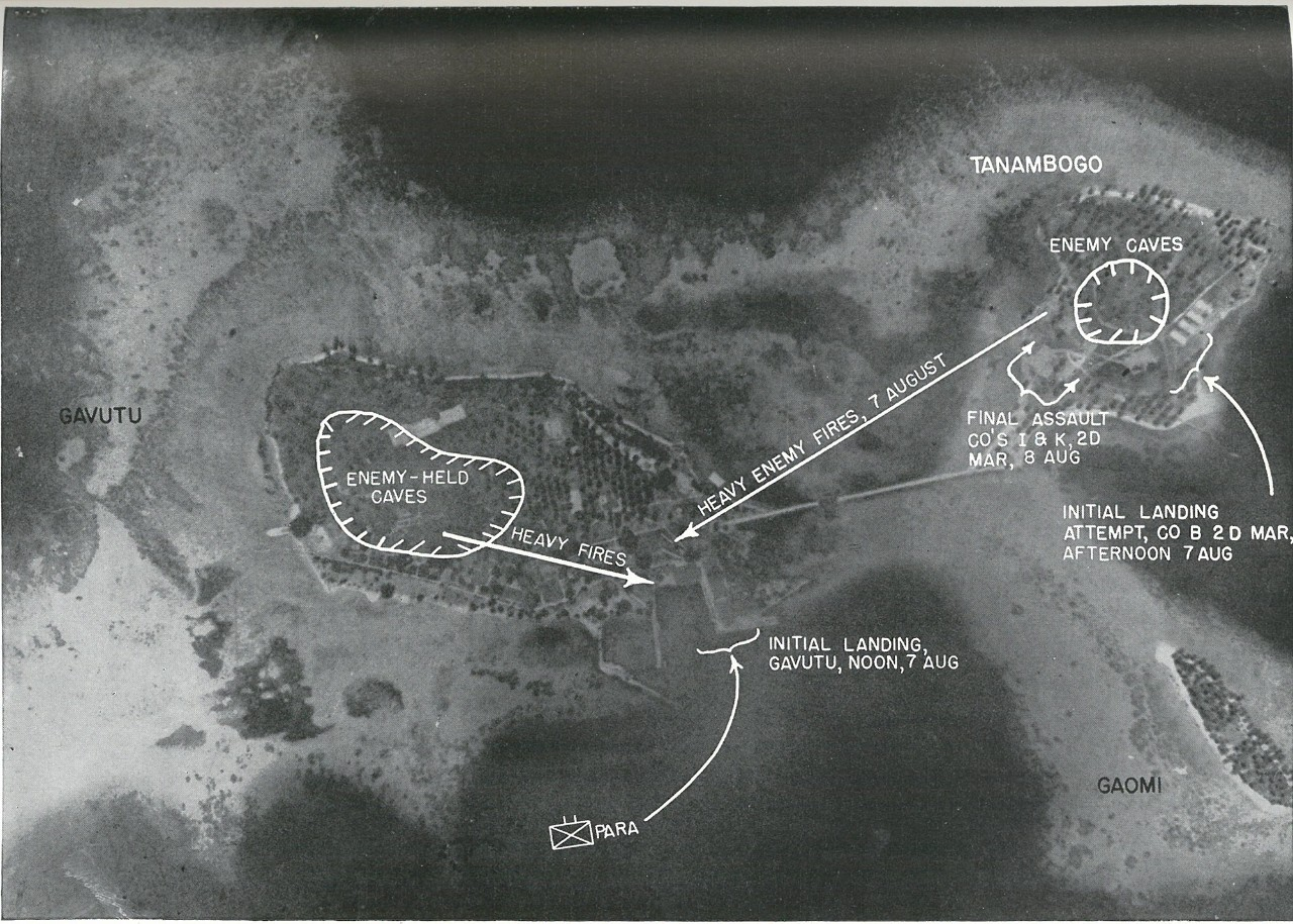 SURPRISE WAS IMPOSSIBLE in the bitterly contested Gavutu-Tanambogo landings as depicted in this overprint. The photograph itself was taken by Japanese aircraft early in 1942 prior to enemy seizure of the Tulagi-Guadalcanal area.