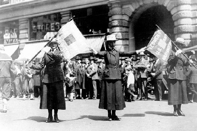 Yeomen (F) from Washington, D.C. Pose with their unit flags during a Victory Loan parade in New York City, May 1919