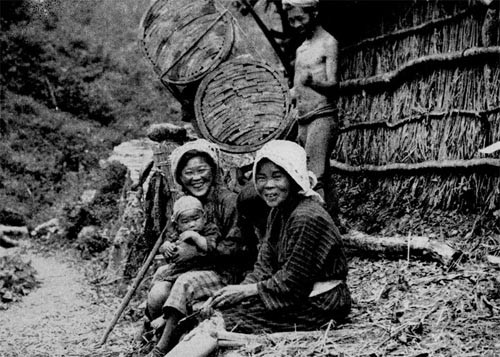 Wood Carriers Resting on a Steep Mountain Path