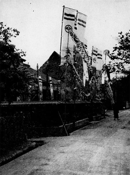Boy Day (May 5) - Special banners and paper fish erected before a house where a son was born during the past year.