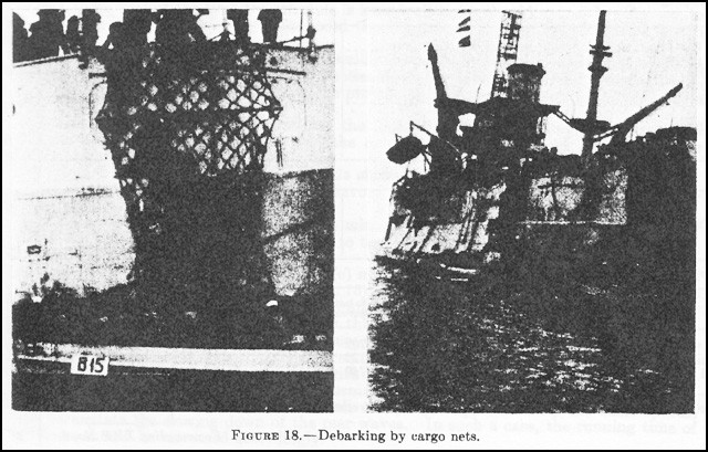 Figure 18. - Debarking by cargo nets.