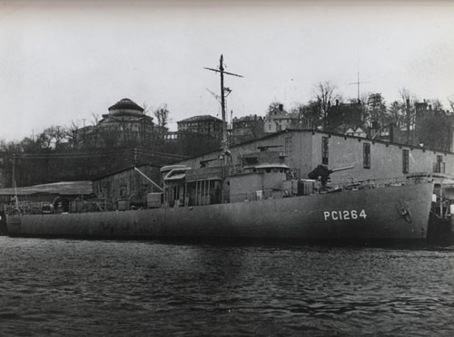 """'Subchaser manned by Negroes commissioned.' The PC-1264, second naval vessel to be manned by a predominantly Negro crew, is shown just before it was commissioned on 25 April 1944."""