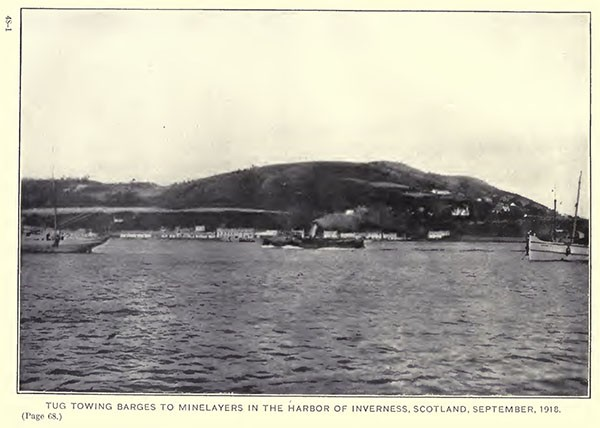 Tug towing barges to minelayers in the harbor of Inverness, Scotland, September, 1918.