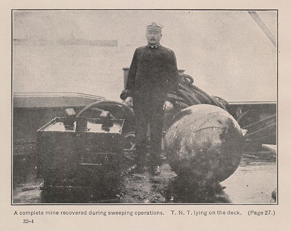 A complete mine recovered during sweeping operations. T. N. T. lying on the deck. (Page 27.)