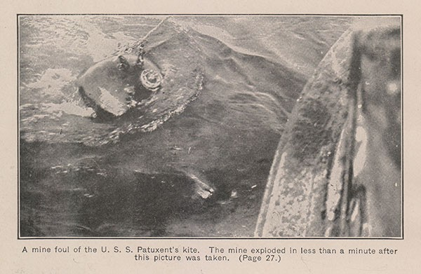 A mine foul of the U. S. S. Patuxent's kite. The mine exploded in less than a minute after this picture was taken. (Page 27.)