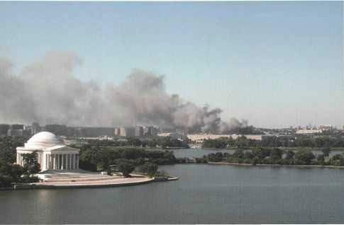 View of the burning Pentagon from the Washington side of the Potomac.