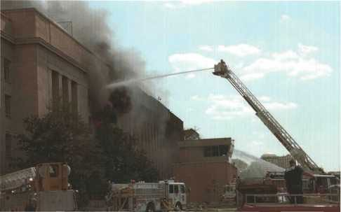 District of Columbia Fire Department Tower 10 fighting fire in upper stories.