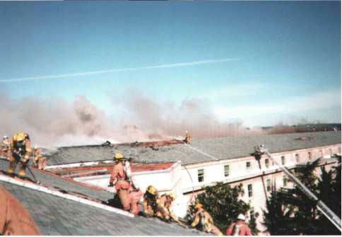 Firefighters battle the roof fire on the morning of 12 September 2001.