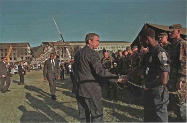 President Bush thanks responders while visiting the Pentagon crash site on 12 September 2001.