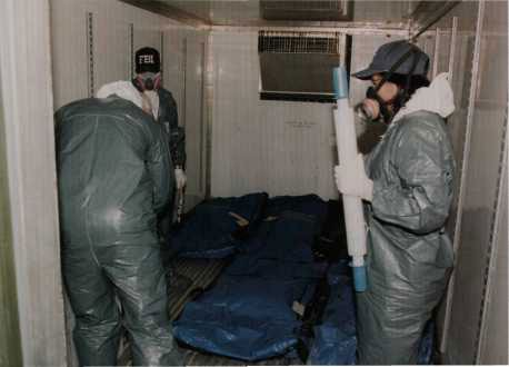 Preparing to transport body bags.