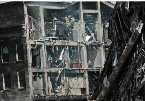 Damaged interior offices sheared open by the collapse of the E Ring.