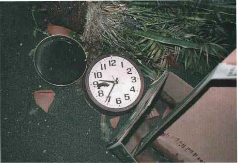"Clock in Room 3E452, located near the ""hinge"" of the collapsed floors. The 9/11 Commission determined that the plane hit the building at 9:37 a.m."