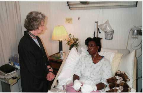 Joyce Rumsfeld, the wife of the defense secretary, visits Sheila Moody, 13 September 2001.