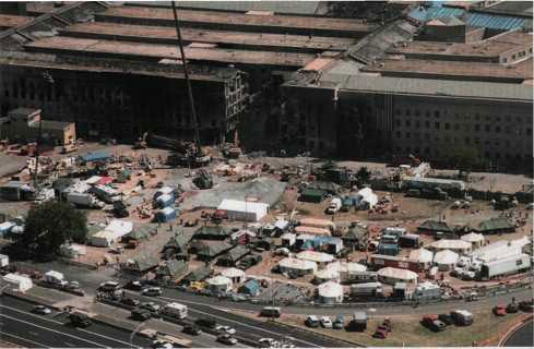 Days after the attack, the lawn west of the Pentagon filled with vehicles, equipment, and tents for command and control, search and recovery, shoring, demolition, and security.