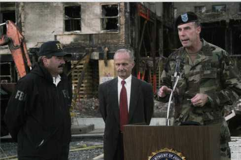 FBI representatives Arthur Eberhart and Van A. Harp (left) hand over management of the crash site to Major General James Jackson, Commander, U.S. Army Military District of Washington, 26 September 2001.