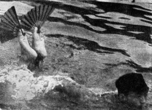 "But what we overlooked was this: The little man swimming with his feet out of the water was learning to carry military code messages between his toes ""in front of the enemy stealthily."""