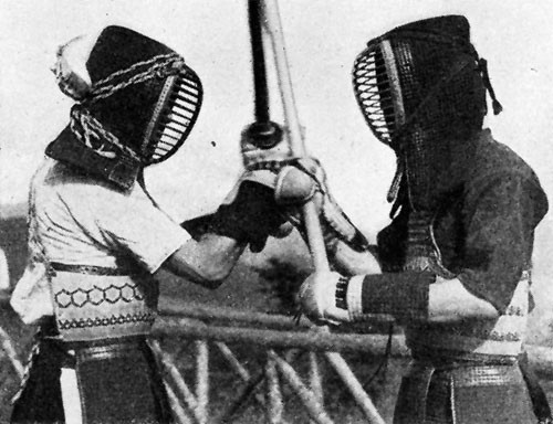 "The boys practicing ""Kendo"" were really strengthening themselves for war by beating each other over the heads with sticks."