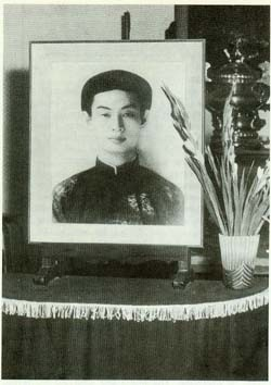Hoa Hao altar bears portrait of religion's founder, Huyen Phu So.