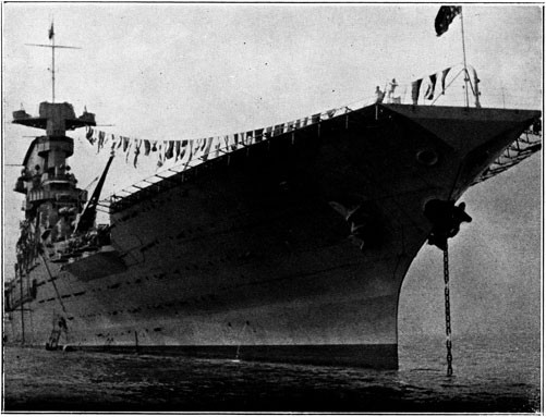 Image of USS Lexington with flags strung.