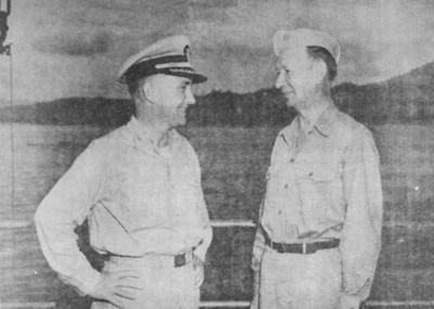 Rear Admiral ALBERT G. NOBLE, U.S. Navy (right), Chief of Staff, Seventh Amphibious Force and later second Commander, Amphibious Group Eight with Commodore RAY TARBUCK, U.S. Navy (left), his successor as Chief of Staff on the occasion of his detachment.