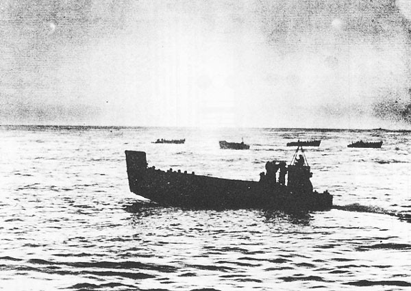 A group of five landing craft.