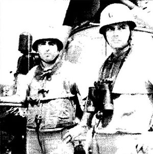 Captain John J. Herrick (left), the on-site task force commander, and Commander Herbert Ogler, commanding officer of the Maddox