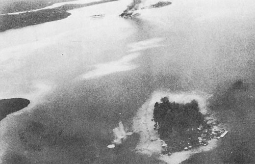 Image of 'Makambo Island under bombardment, Gavutu and Tanambogo in background.'