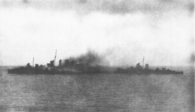 Destroyers removing personnel from the Canberra.