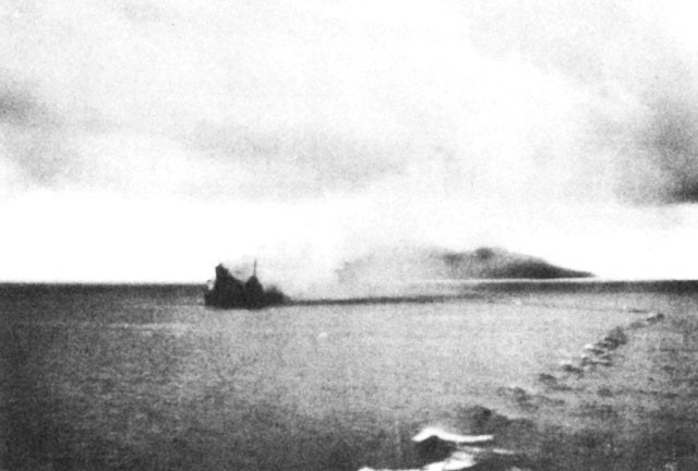 Canberra with destroyer alongside, Savo Island in background.