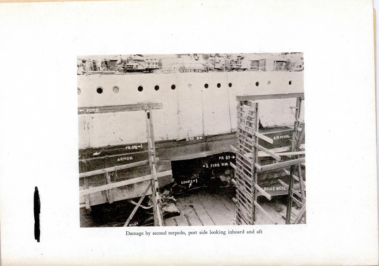 Damage by second torpedo, port side looking inboard and aft