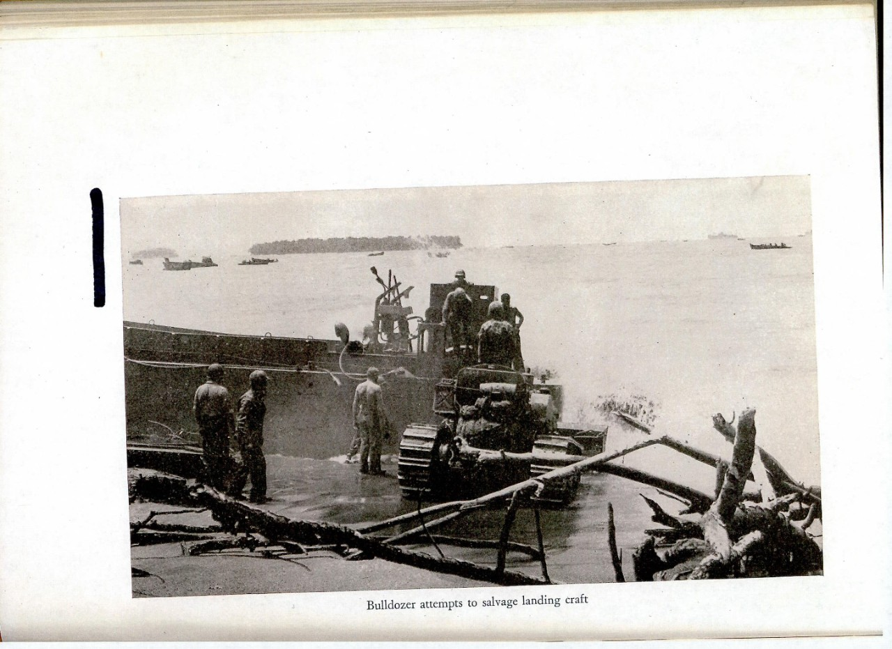 Bulldozer attempts to salvage landing craft