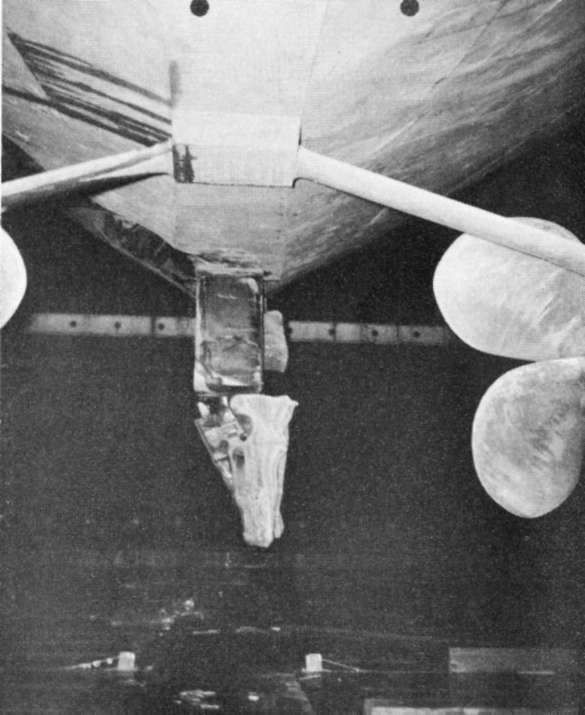 Photo 75: INTREPID (CV 11) Looking aft at damaged rudder and missing fairing piece.