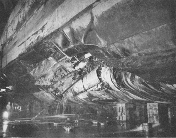 Photo 26: CANBERRA (CA 70) Looking aft at torpedo damage.
