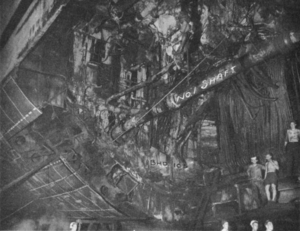Photo 28: CANBERRA (CA 70) Looking aft at torpedo hole after removal of damaged structure.