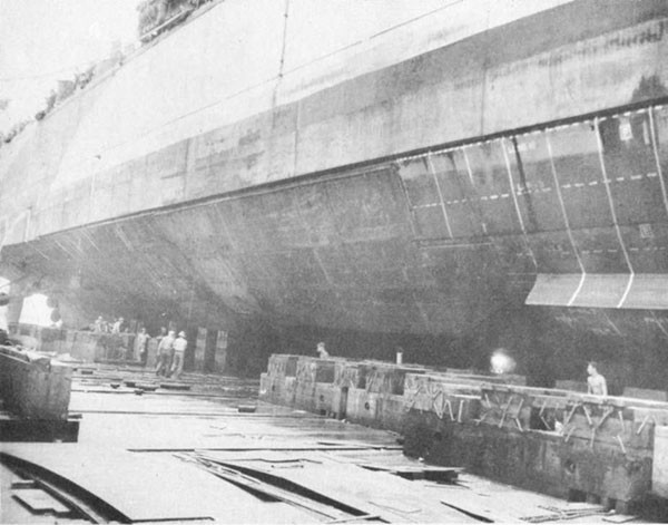 Photo 31: CANBERRA (CA 70) Looking aft at completed repairs to underwater body.